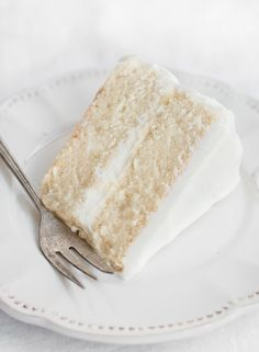 DOUBLE THIS! The most amazing white cake. Flavorful, fluffy, and super moist.