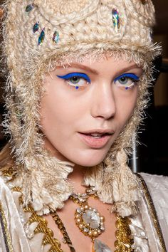 A different take on cat-eye / winged makeup with azure blue lines created by Pat McGrath for Anna Sui w/f 2012.