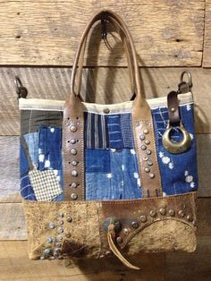 J. Augur Like the distressed leather with metal details