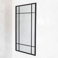 Framed in a sleek black metal frame, the central mirror glass features vertical and horizontal bars to create the effect of an industrial style window. Living Room Loft, Black Metal Frame, Industrial Style, Mirror Inspiration, Black Living Room Decor, Living Room Mirrors, Iron Stools, Industrial Mirrors, Mirror