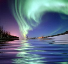 Aurora Borealis, the colored lights seen in the skies around the North Pole, the Northern Lights, from Bear Lake, Alaska ...