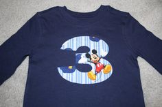 Mickey Mouse age shirt.  So cute for your little boy's birthday party.