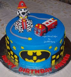 """Paw Patrol & Batman - 10"""" cake iced in buttercream with hand made fondant figures & decorations. We made this cake for a little boy who loves batman & paw patrol. TFL!"""
