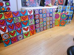 These all make me smile, love the idea of divided canvas with repeating shapes in varying colours