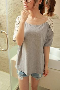 This T-shirt crafted in cotton, featuring cut-out lace shoulder design and cut-out deign of back, round neckline, short sleeves, in medium length cut, all in loose fit.