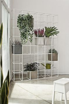 Not into the linen planters but I like the sight of plants within a grid. Planting system by Supercake