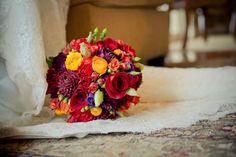 Bridal bouquet with dahlias, ranunculus and hypericum :  wedding bouquet brown dahlias flowers gold hypericum lisianthus orange purple ranunculus red roses spray roses yellow  72 2