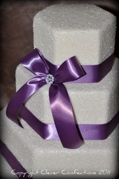 www.cleverconfections.com...encrusted with sugar crystals and accented with ribbon and rhinestones!