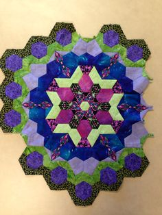 Katja Marek's The New Hexagon - Millefiore Quilt-Along: Rosette 4: Complete! By Tracy Pierceall, 1/12/2016 (I'm finally getting back into this project after completing some UFOs that needed attention.)