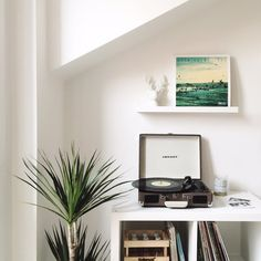 Our little music corner where the Crosley record player is the centre of attention. Over the shelf we have the small Mosslanda white picture ledge which gives the perfect space for displaying vinyl records as well as art or any small decorative objects. I love it because it gives me the freedom to change what I have on it quite frequently // thatscandinavianfeeling.com
