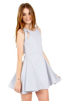 The Sugarlips Futurama Dress is a blue and white gingham fit and flare dress. Features unique cutout details in the front. Racerback. Exposed zipper closure on back. Pair it with patent loafers and bowler hat to complete the look. #MyLuluCloset #Sugarlips #Storenvy #Sales #Dresses
