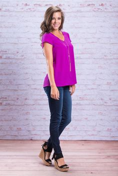 We know you fashionistas out there are always on the lookout for anything you can style your own way! This bright violet top can be paired and mixed and matched with so many different bottoms and accessories! The neckline has such a simple, yet perfect, detail around it that just gives this solid top a little something extra!