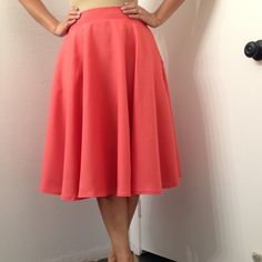 """Hot pink party Gorgeous handmade full midi circle skirt. This hot pink gem has pockets on each side of the skirt and a back zipper. It's got a great simple classic look with or with out crinoline (crinoline not included) it's great with flats and high heels. Show off your fabulousness with this chic skirt! Measures: 26"""" waist and 26"""" length Mimi Cariño Skirts Midi"""