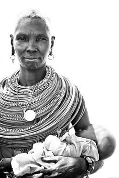 Africa | A Samburu woman with a baby. Samburu National Reserve, Kenya | © Robin Moore