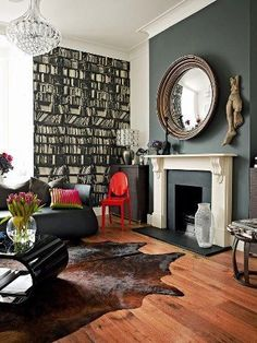A cowhide rug fitting seamlessly into another room furrugs.com