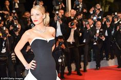 Gorgeous: The star wore a strapless monochrome gown that was the perfect balance of elegan...