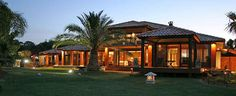 BALI HOUSE. Extensively themed home with Balinese influence