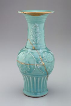 aleyma:    Longquan ware vase, made in China in the 2nd half of the 13th century. The gold lacquer repairs were made later when the vase was in Japan. (source).