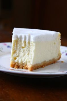 Coconut Cheesecake Recipe ~ Absolutely perfect. Creamy, smooth, not too sweet, light and without a single crack on top. But the best part... was the frosting. It was TO DIE FOR.