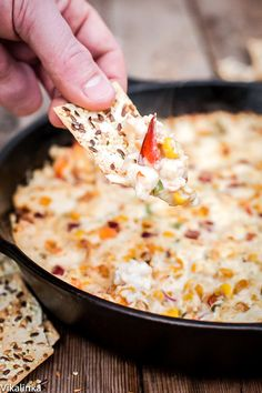 This hot and cheesy dip full of crab chunks and roasted corn will be ...