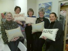 Happy customers with their finished cushions