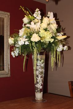 Tall glass wedding centerpiece, submerged orchid, green and white, submersed LED light