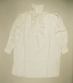 Early 19th century American Shirt. The museum suggests 18th century but if it is it is 1790s. Notice each cuff is set for sleeve buttons. The bosom ruffle is quite large. Accession Number: C.I.41.146.5 at the MET