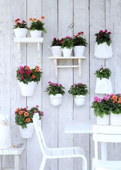Lack of space? Use the fence to hold pots and shelving. Sweet & cheerful.