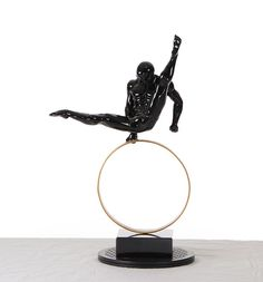 Need some accent pieces for you man cave? Try the  muscular Gymnast Sculpture