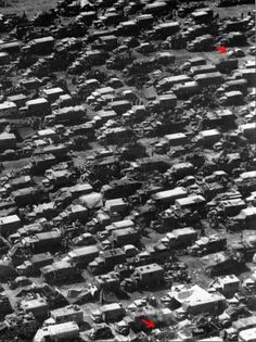 This is an amazing photograph of German vehicles attempting to escape from the closing noose of the Allied armies. They are attempting to cross one of the remaining bridges outside of Aachen in 1945. This photo was taken by an American recon plane.