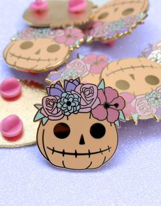 A gold hard enamel pin of a cute Halloween pumpkin, with flowers. wide with two pink pin clutches. Halloween Flowers, Cute Halloween, Halloween Pumpkins, Pumpkin Flower, Cute Pumpkin, Cool Pins, Hard Enamel Pin, Pin And Patches, Pin Badges