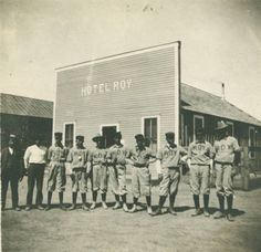 Roy baseball team in front of the Roy Hotel, Roy, New Mexico, ca. 1900-1920. Palace of the Governors Photo Archives HP.2012.20.14.