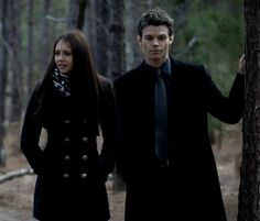 Elena Gilbert and Elijah Mikaelson on the woods (on black suits)