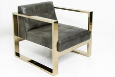 grey and brass chair