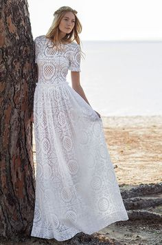 Wedding dress with high-rez neckline and short sleeves. See photos of Costarellos Bridal's Spring 2016 wedding dress collection.