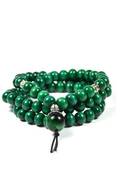 Wraparound bracelet with 8mm natural wood beads. It wraps around 3 times and features a 14mm green tiger eye accent piece.
