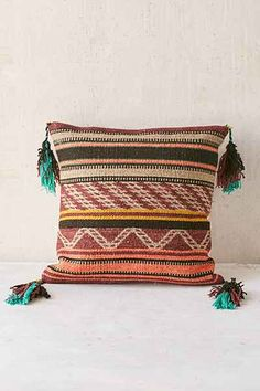 warm tones in this boho kilim pillow with tassels
