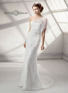 Lavish beaded tulle adorns a satin sheath in this dainty sheath wedding dress, Skye by Sottero and Midgley. We love the one-shoulder!