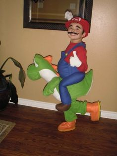 23 Super Mario and Luigi Costumes - Super Mario riding Yoshi in Super Mario World.