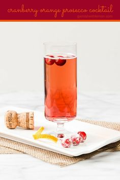 Bubbles add instant sparkle to a drink. This Cranberry Orange Prosecco Cocktail is the perfect way to toast friends and family this holiday season. ~ http://www.garnishwithlemon.com