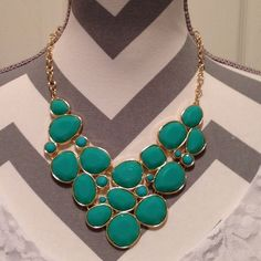 Green Jeweled necklace Green big jeweled necklace! Perfect for any plain shirt that just needs something extra!! Forever 21 Jewelry Necklaces