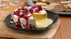 Looking for a quick-and-easy, can't-miss appetizer, for the holidays or any time? This warm, creamy brie round topped in cranberries and almonds requires just 5 ingredients and 5 minutes prep time.