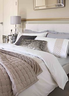Boutique Bedroom. Be bold in the bedroom with statement mirrored furniture. Sumptuous silks, sequins and metallic embroidery create a feeling of refinery.