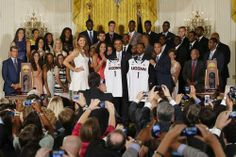President Barack Obama poses with UConn women's basketball stars Stefanie Dolson (L) and Bria Hartley (2nd L) and men's team stars Ryan Boat...