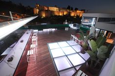 Rooftop bar of Batik, Malaga city with uninterrupted views of the Alcazaba fortress.