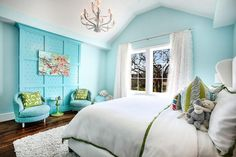 This relaxing contemporary blue girl's bedroom is the perfect place to hang out.