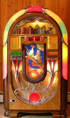 Wurlitzer Model 850 1941 Peacock Jukebox. This was the first jukebox to use an electric selector as opposed to a mechanical one.