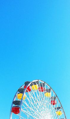 Here's to having a high roller of a week, you guys   Taken at Santa Monica Pier   Yellow and Red Ferris Wheel - Blue Sky.