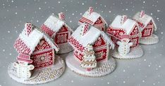 Miniature gingerbread houses: look at them in all their red and white detailed glory!very pretty indeed! love the artistic piping! Gingerbread House Parties, Christmas Gingerbread House, Christmas Sweets, Christmas Cooking, Noel Christmas, Christmas Goodies, Christmas Candy, Gingerbread Cookies, Gingerbread Houses