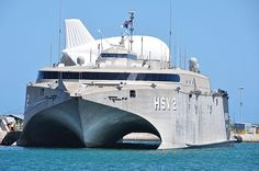 The Military Sealift Command high-speed vessel Swift (HSV 2) and a tethered TIF-25K aerostat are moored at Mole Pier at Naval Air Station Key West prior to at sea testing for future Operation Martillo counter transnational organized crime operations while assigned to U.S. 4th Fleet.